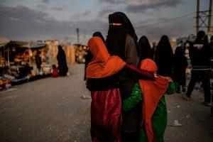 Muslim woman in burqua with two female children