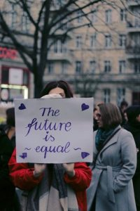 Women holding a sign reading 'The future is equal'